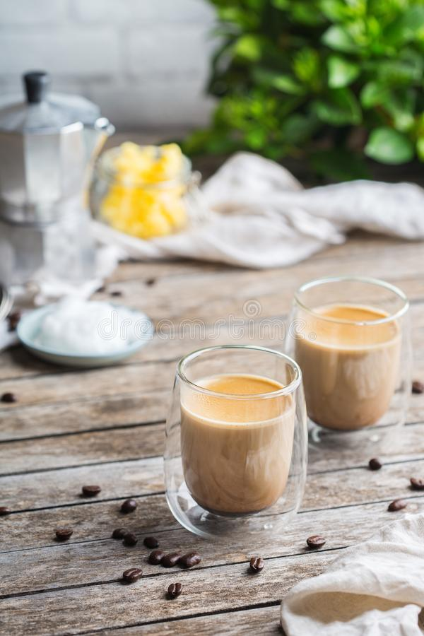 Keto, ketogenic bulletproof coffee with coconut oil and ghee butter. Healthy clean eating concept, keto, ketogenic diet, breakfast morning table. Brewed stock images