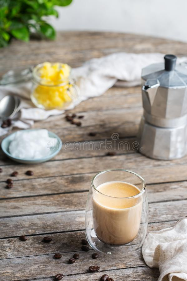 Keto, ketogenic bulletproof coffee with coconut oil and ghee butter. Healthy clean eating concept, keto, ketogenic diet, breakfast morning table. Brewed stock photography