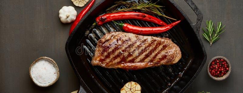 Keto ketogenic diet beef steak, fried striploin on grill pan. Paleo food recipe with meat, seasoning stock photo