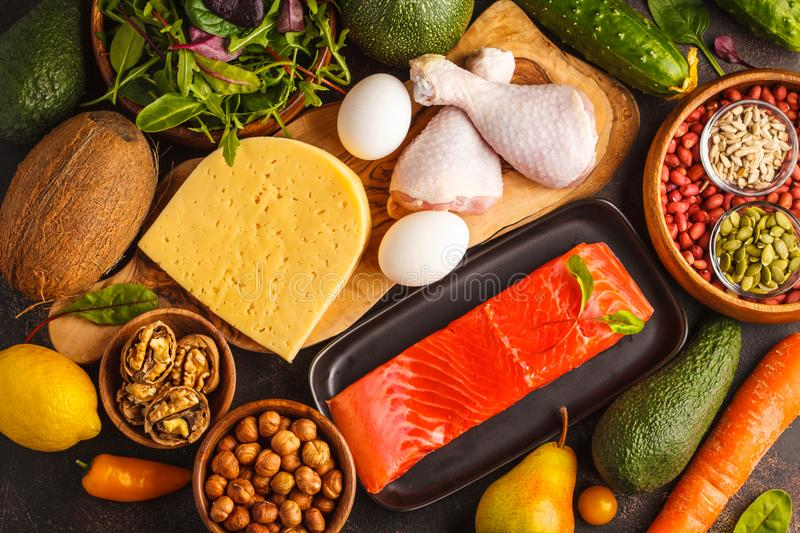 Keto ketogenic diet concept. Balanced low-carb food background. Keto diet concept. Balanced low-carb food background. Vegetables, fish, meat, cheese, nuts on a royalty free stock photos