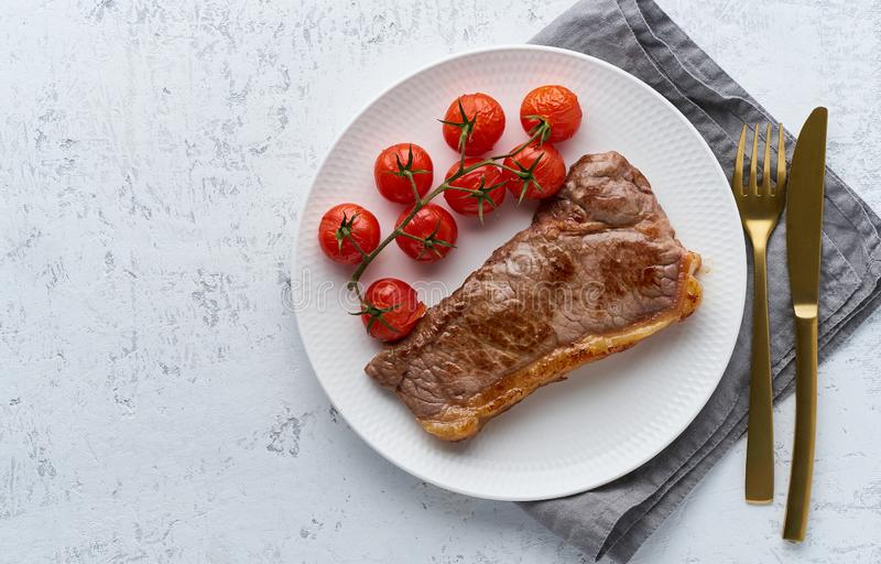 Keto ketogenic diet steak with tomatoes on white background, top view stock image