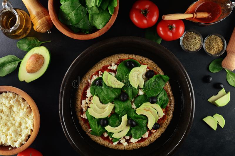 Keto Pizza with Sugar Free Tomato Paste, Crumbled Cheese, Spinach, Avocado and Olives. A set of photos showing low-carb, sugar-free keto diet pizza with keto stock photo