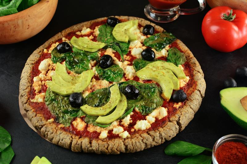 Keto Pizza with Sugar Free Tomato Paste, Crumbled Cheese, Spinach, Avocado and Olives. A set of photos showing low-carb, sugar-free keto diet pizza with keto stock photos