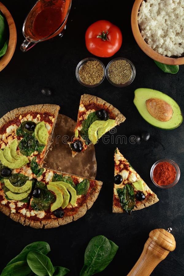 Keto Pizza with Sugar Free Tomato Paste, Crumbled Cheese, Spinach, Avocado and Olives. A set of photos showing low-carb, sugar-free keto diet pizza with keto stock photography