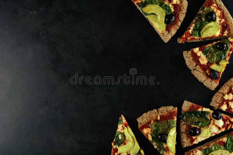 Keto Pizza with Sugar Free Tomato Paste, Crumbled Cheese, Spinach, Avocado and Olives. A set of photos showing low-carb, sugar-free keto diet pizza with keto stock image