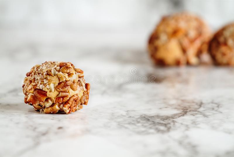 Keto Pumpkin Pie Fat Bombs. Made with pumpkin, pecan nuts, coconut oil and other fats..Selective focus with blurred background. Ketogenic diet concept royalty free stock photography