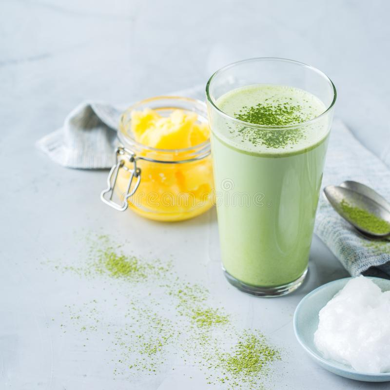 Ketogenic bulletproof matcha latte tea, coconut oil and ghee butter. Healthy clean eating concept, keto, ketogenic diet, breakfast morning table. Bulletproof stock photography