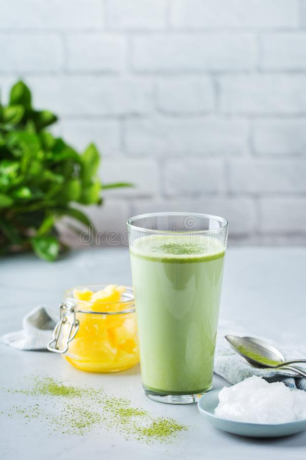 Ketogenic bulletproof matcha latte tea, coconut oil and ghee butter. Healthy clean eating concept, keto, ketogenic diet, breakfast morning table. Bulletproof stock images