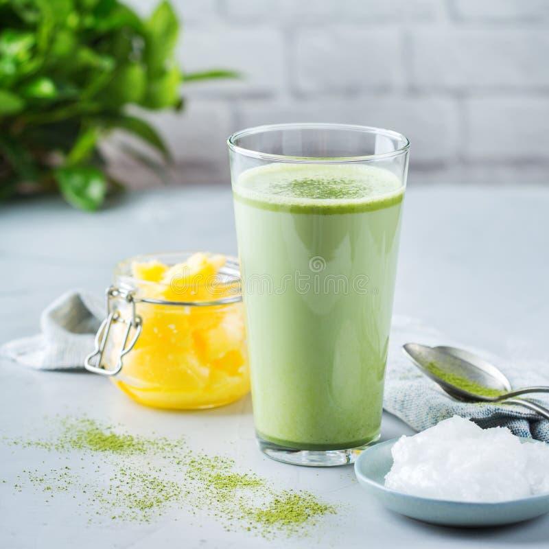 Ketogenic bulletproof matcha latte tea, coconut oil and ghee butter. Healthy clean eating concept, keto, ketogenic diet, breakfast morning table. Bulletproof stock photo