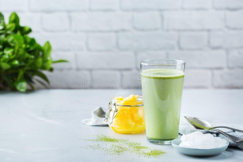 Ketogenic bulletproof matcha latte tea, coconut oil and ghee butter. Healthy clean eating concept, keto, ketogenic diet, breakfast morning table. Bulletproof stock image