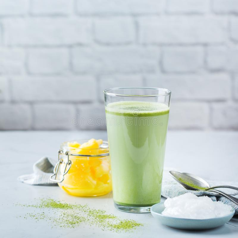 Ketogenic bulletproof matcha latte tea, coconut oil and ghee butter. Healthy clean eating concept, keto, ketogenic diet, breakfast morning table. Bulletproof royalty free stock photo