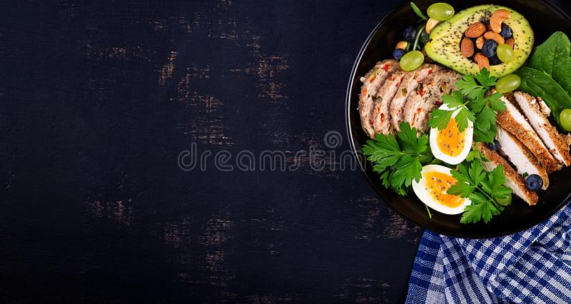 Ketogenic diet. Buddha bowl dish with meatloaf, chicken meat, avocado, berries and nuts. Detox and healthy concept. Keto food. stock image