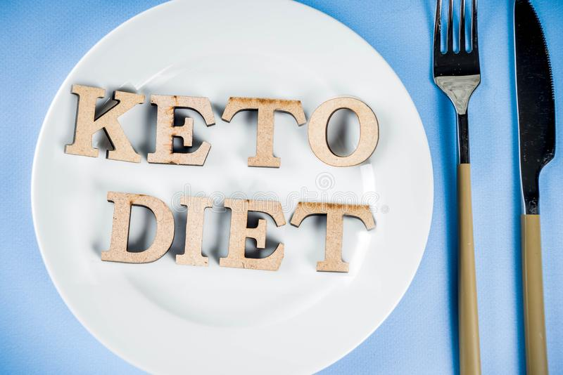 Ketogenic diet concept. Healthy food background, plate, fork, knife, with Keto diet stock image