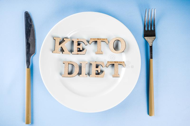 Ketogenic diet concept. Healthy food background, plate, fork, knife, with Keto diet royalty free stock photos