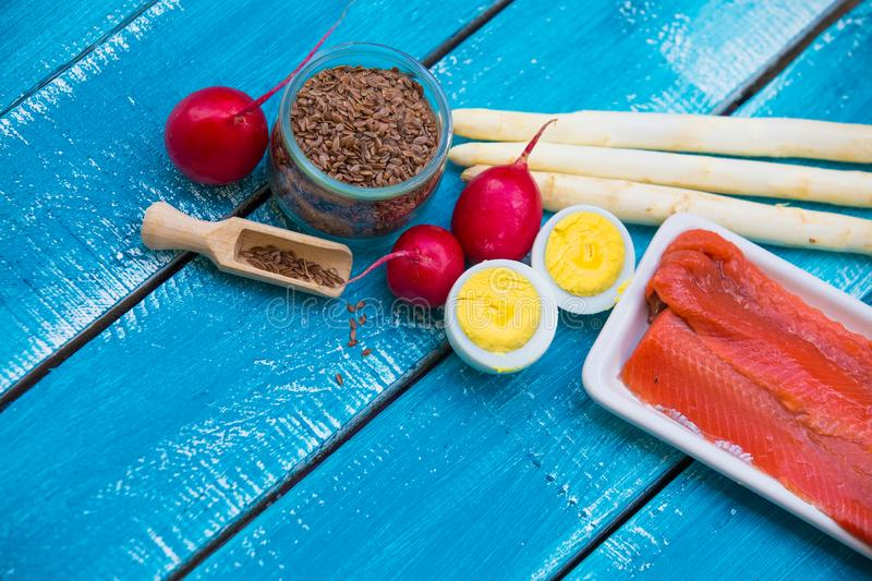 Ketogenic diet low carb foods. On blue wooden background stock photography