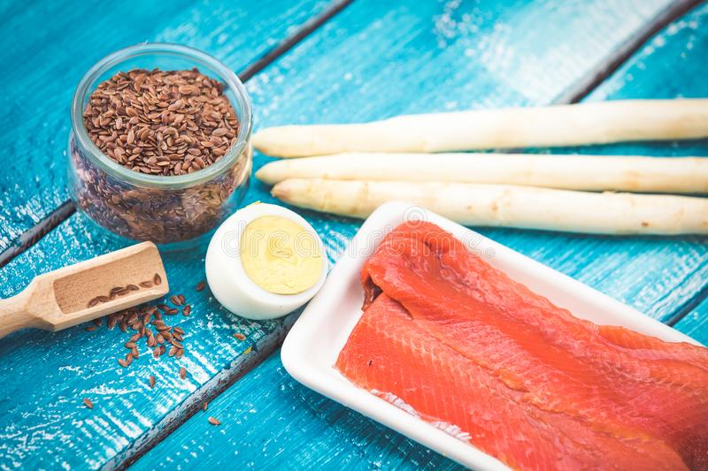Ketogenic diet low carb foods. On blue wooden background royalty free stock image