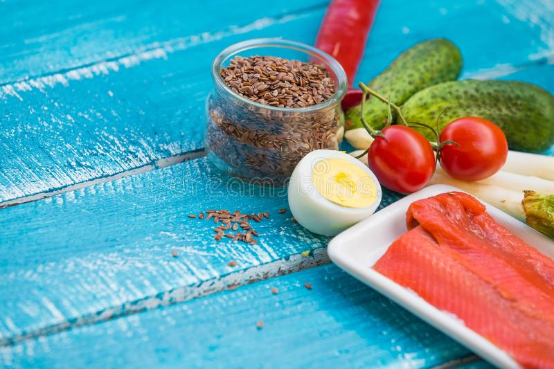 Ketogenic diet low carb foods. On blue wooden background stock photo