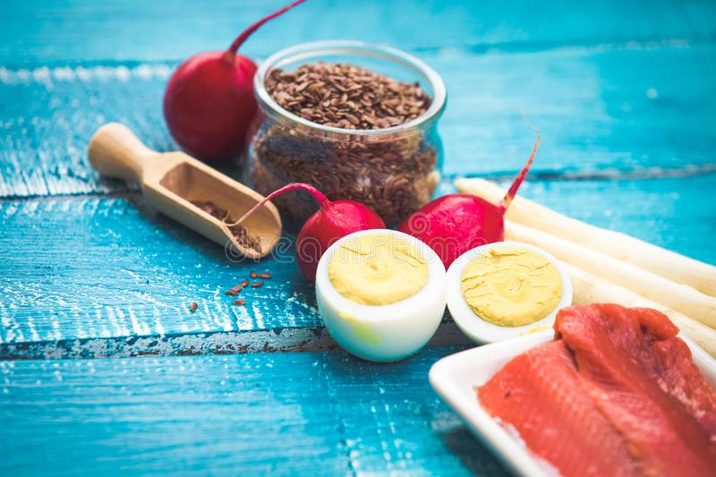 Ketogenic diet low carb foods. On blue wooden background stock images