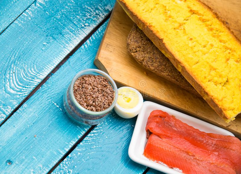 Ketogenic diet low carb foods. On blue wooden background royalty free stock photos