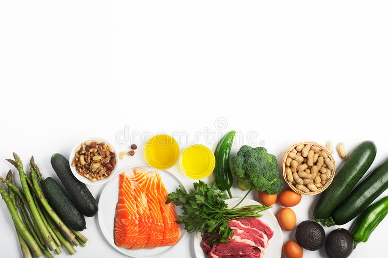 Ketogenic, keto diet, including vegetables, meat and fish, nuts and oil on white background with copy space. Ketogenic, keto diet, including vegetables, meat and stock photos