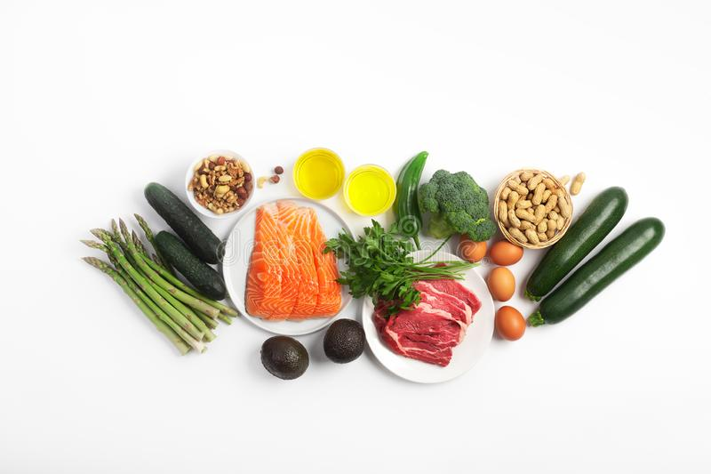 Ketogenic, keto diet, including vegetables, meat and fish, nuts and oil on white background. Ketogenic, keto diet, including vegetables, meat and fish, nuts and stock photo