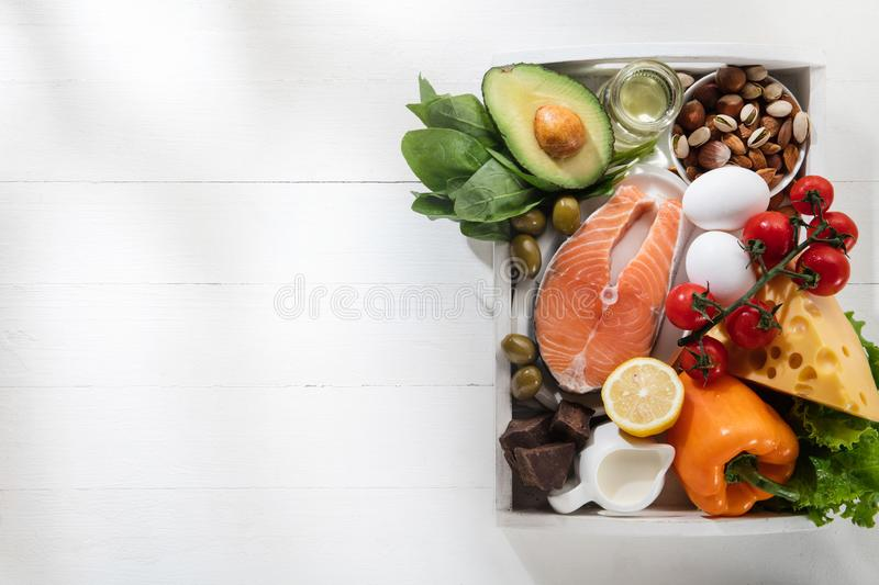 Ketogenic low carbs diet - food selection on white background stock photography