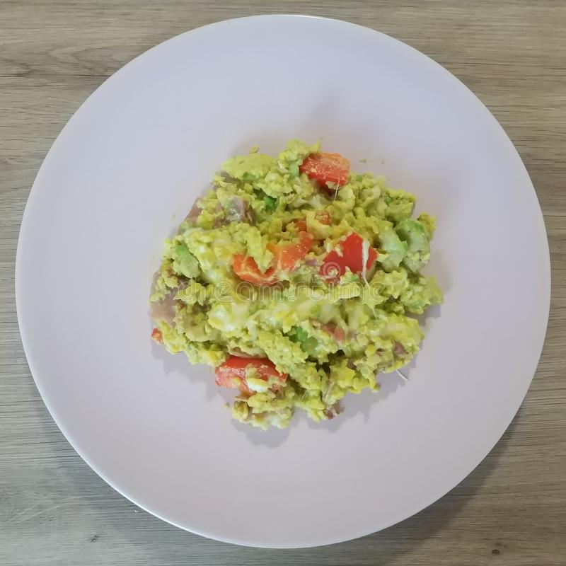 Ketogenic meal, avocado, bacon, cauliflower, tomatoes. Keto food for weight loss. Healthy diet lunch. stock photography