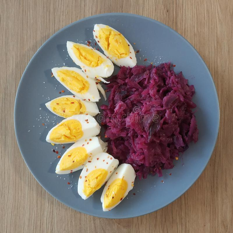 Ketogenic meal, boiled eggs with red cabbage. Keto food for weight loss. Healthy diet breakfast, dinner. stock photos