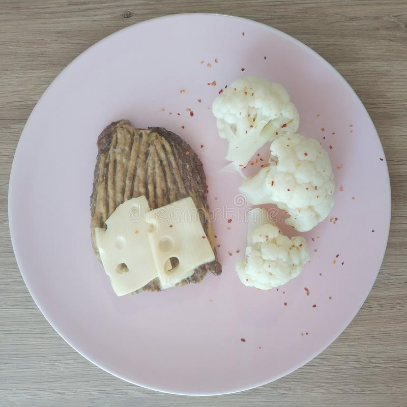 Ketogenic meal, cheese beef steak with cauliflower. Keto food weight loss. Ketogenic meal, cheese beef steak with cauliflower. Keto food weight. Weight, loss royalty free stock photography