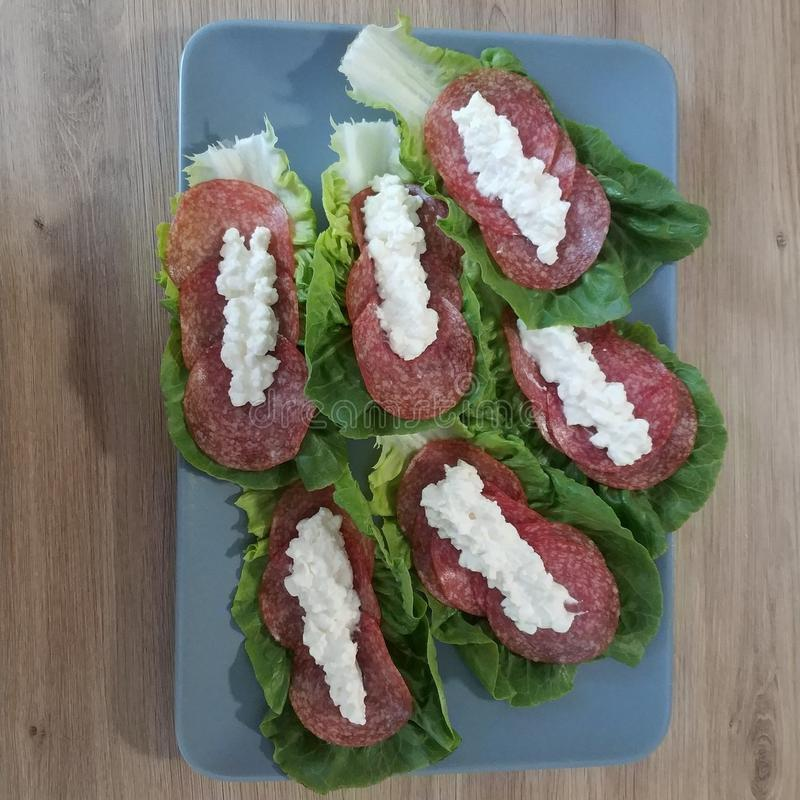 Ketogenic meal, cottage cheese with salami and lettuce. Keto food for weight loss. Diet, breakfast, dinner stock photography