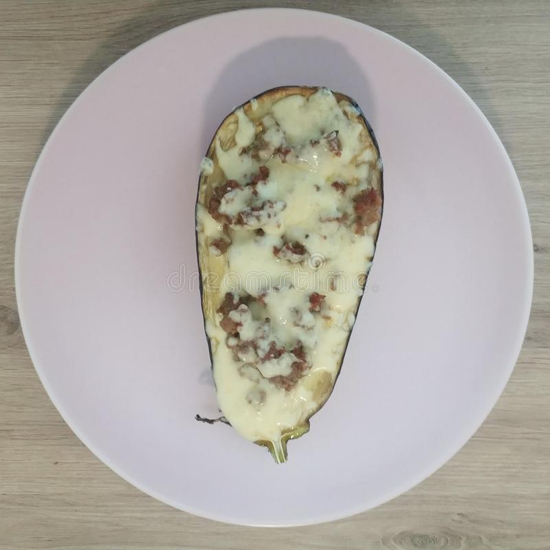 Ketogenic meal, eggplant stuffed with cheese ground beef. Keto food for weight loss. Healthy diet lunch. Ketogenic meal, eggplant stuffed with cheese ground stock images
