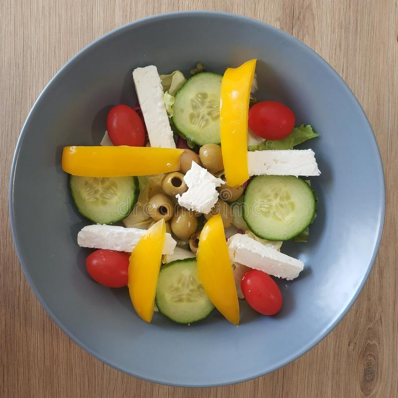 Ketogenic meal, feta cheese salad with tomato, cucumber, olive, bell pepper. Keto food for weight loss. Healthy diet breakfast royalty free stock image