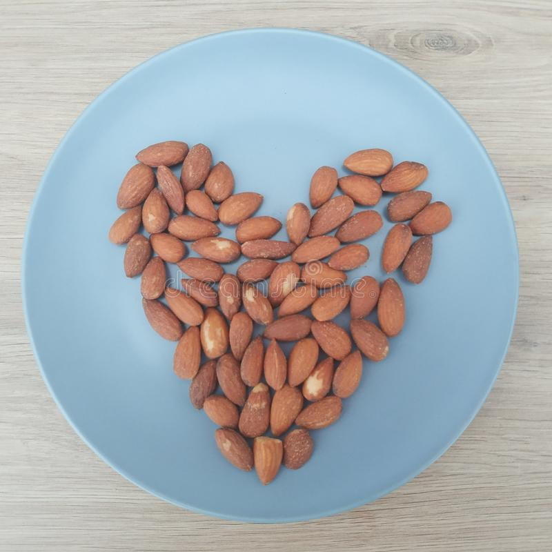 Ketogenic meal, heart shaped almonds. Keto food for weight loss royalty free stock photo