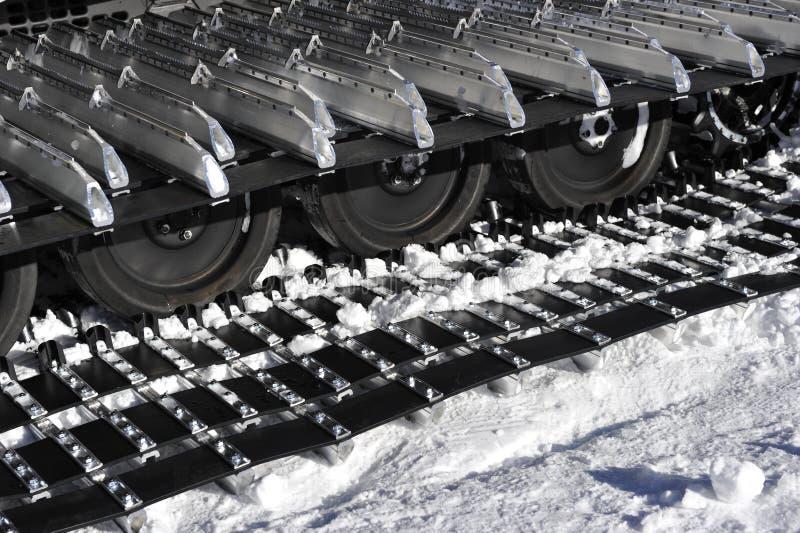 Kette der Schnee-Gleiskette stockfoto