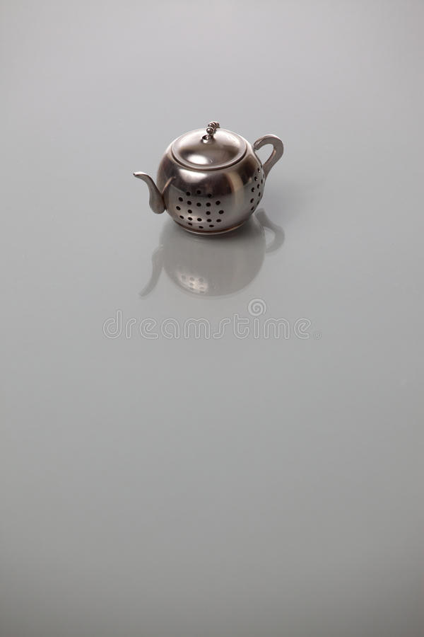 Kettle. Isolated small kettle on a gray background royalty free stock photography