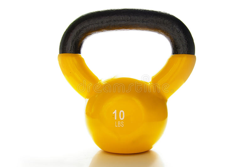 Kettle bell. Yellow kettle-bell weight, isolated on white background royalty free stock image