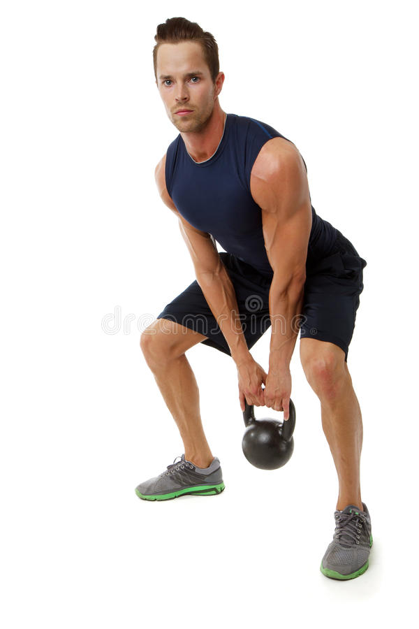 Kettle bell exercise. Young attractive male doing kettle bell cross fit exercise stock image