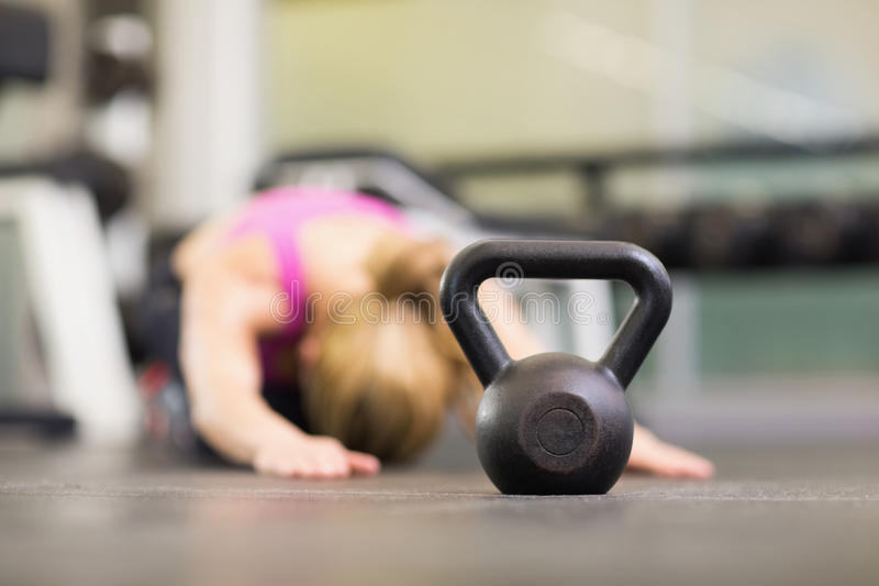 Kettle bell on floor in the gym. Close up of a kettle bell on floor in the gym stock photo
