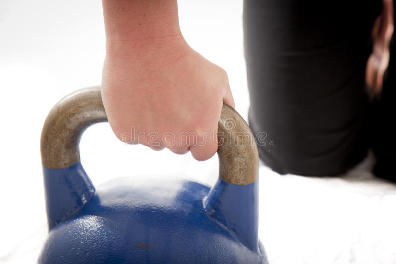 Kettle Bell Grip. Close up of a woman gripping a kettle bell stock photo