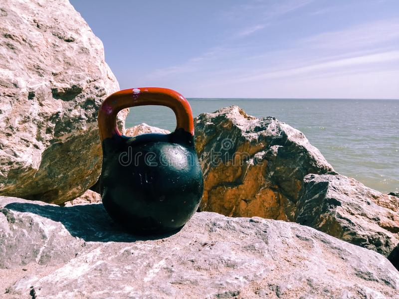 Kettle bell rock. Sea, sky, lifestyle stock photography
