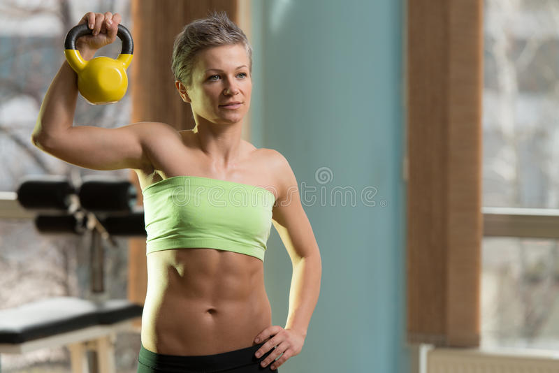 Kettle Bell Workout. Beautiful Athletic Woman Workout With Kettle Bell royalty free stock photo