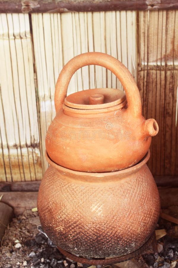 Kettle made of clay pottery royalty free stock photo