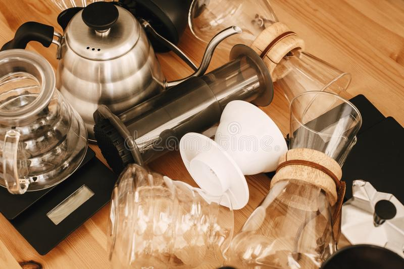 Kettle, scales, geyser, grinder, aeropress, pour over, glass flask top view. Alternative coffee brewing method set, flat lay. royalty free stock image