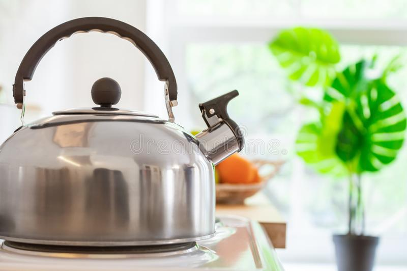 Kettle on the stove in the kitchen. Good morning or breakfast concept. Metal kettle with a whistle stands on an electric stove in the kitchen. Good morning or stock photos