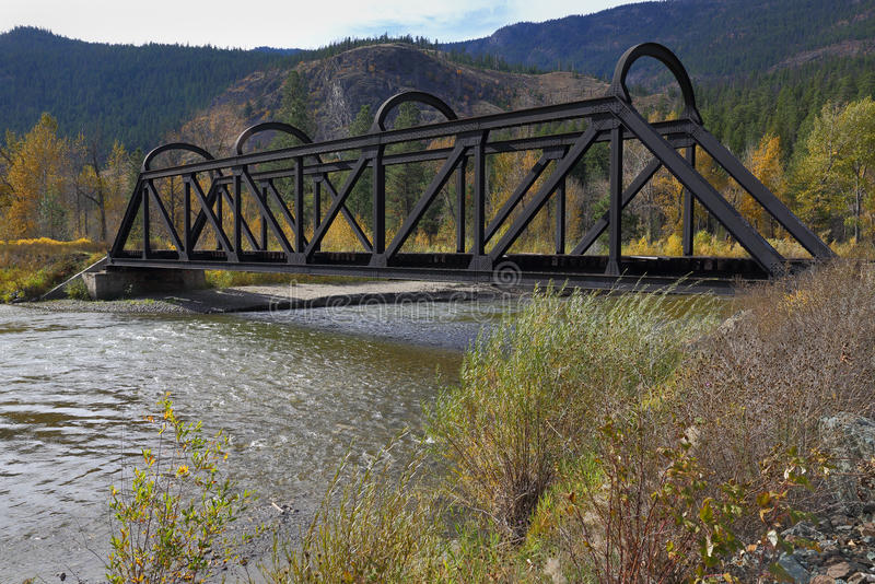Kettle Valley Rail Bridge over the Nicola River. An abandoned rail bridge over the Nicola River. The Kettle Valley Railway used to run on these tracks. British royalty free stock photography