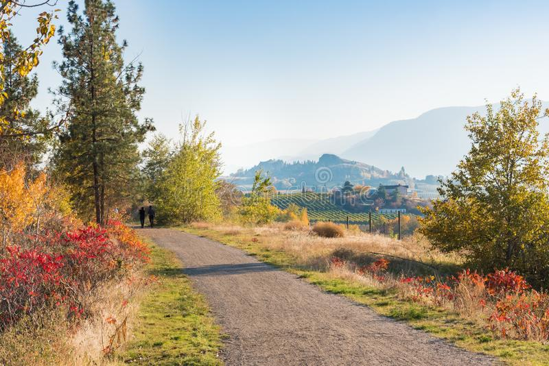 Kettle Valley Rail Trail near Penticton with view of vineyards and Munson Mountain stock images
