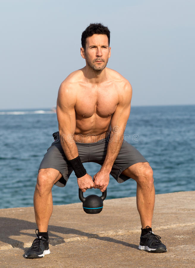 Kettlebell Bizeps Exercise On The Beach Stock Photo - Image of ...