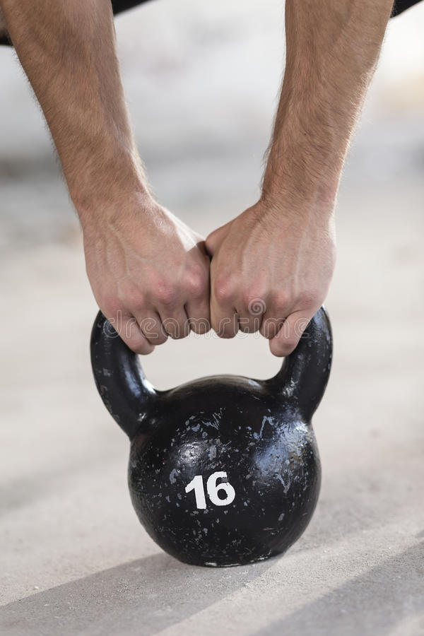 Arm Of Man And Woman Lifting Weights Stock Image - Image