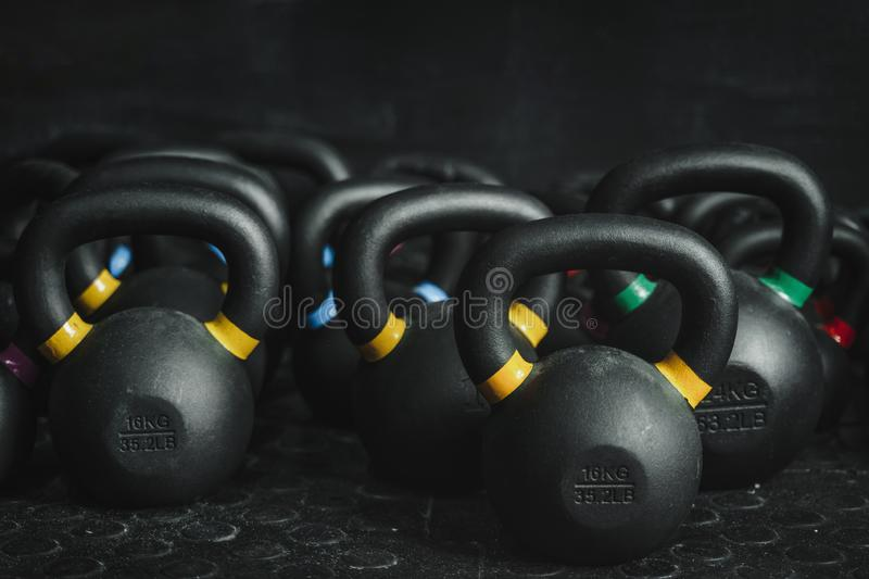 Kettlebells on dark backgroud at the crossfit gym. Kettlebells equipment on dark backgroud at the crossfit gym. Sport concept royalty free stock image