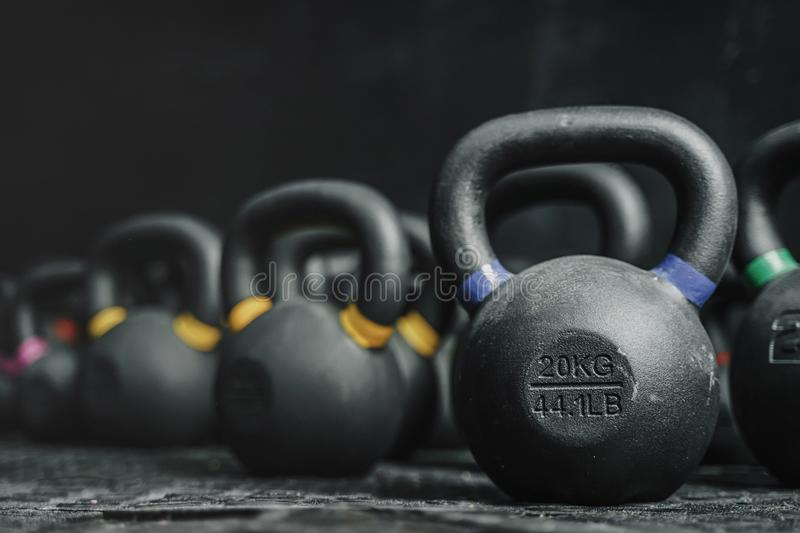 Kettlebells on dark backgroud at the crossfit gym. Kettlebells equipment on dark backgroud at the crossfit gym. Sport concept. Copy space royalty free stock photos
